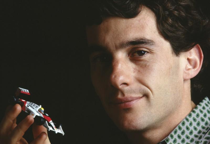 Ayrton_Senna_with_toy_car_cropped_no_wm.jpg